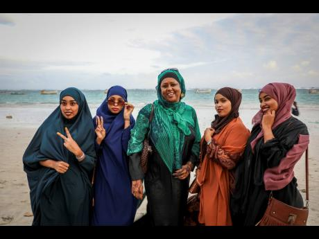 Somali parliament member Fawzia Yusuf H. Adam (centre) chats with campaign supporters at Lido beach in Mogadishu, Somalia. The woman who broke barriers as the first female foreign minister and deputy prime minister in culturally conservative Somalia now ai
