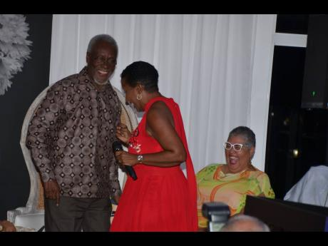 Former Prime Minister P.J. Patterson dances with singer Karen Smith during the launch of his book 'My Political Journey', at the S Hotel in Montego Bay.