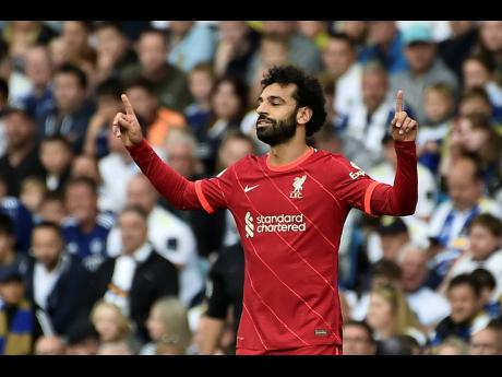 Liverpool's Mohamed Salah celebrates after scoring the opening goal during their English Premier League match against Leeds United at Elland Road, Leeds, England, yesterday.
