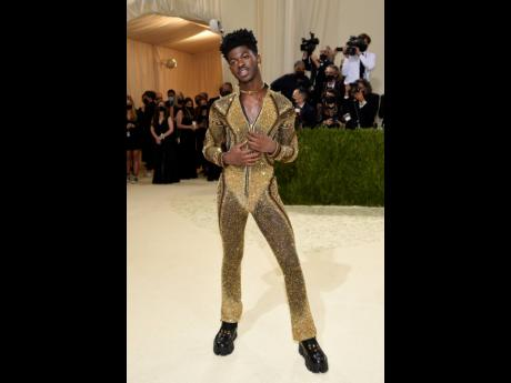 Lil Nas X dons his final look — an embellished jumpsuit.