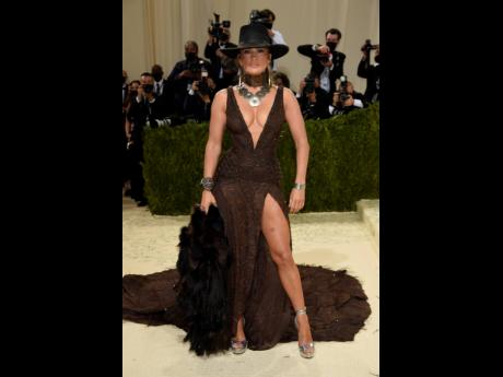 Ralph Lauren dressed Jennifer Lopez in fur with a brown look in her signature plunge at the neck and high slit, a wide-brimmed Western-style hat on her head.
