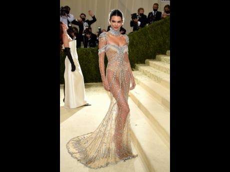 Kendall Jenner wore a glittery, revealing silver look by Givenchy, inspired by 'My Fair Lady'.