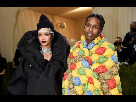 Rihanna (left), ever the Met Gala queen, wore a huge black Balenciaga look and hat accompanied by A$AP Rocky in a multicoloured quilted coat from ERL. She wore over 267 carats of Bulgari diamonds, including two choker necklaces.