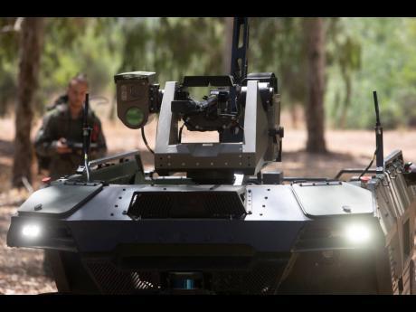 Israel Aerospace Industries' semi-autonomous four-wheel-drive 'REX MKII' is seen at an IAI facility near the central Israeli city of Lod on September 9.