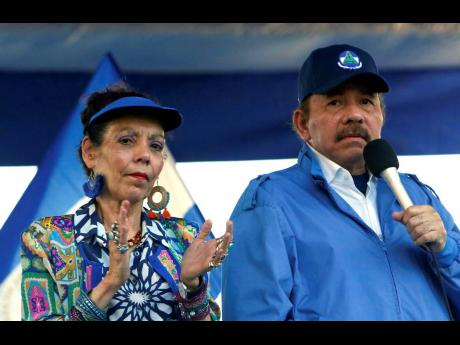 In this September 5, 2018. photo, Nicaragua's President Daniel Ortega and his wife, Vice President Rosario Murillo, lead a rally in Managua, Nicaragua. As international health organisations warn of increasing infections in Nicaragua and independent Nicarag