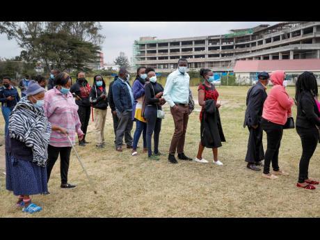 Kenyans queue up to receive the AstraZeneca coronavirus vaccine at Kenyatta National Hospital in Nairobi on August 26.