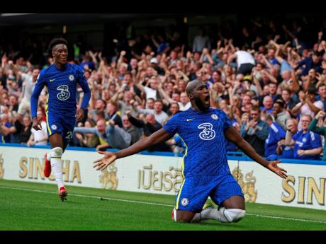 Chelsea's Romelu Lukaku (right) celebrates after scoring his side's opening goal during the English Premier League match against Aston Villa at the Stamford Bridge Stadium in London on Saturday, September 11. Lukaku will be leading Chelsea's charge a