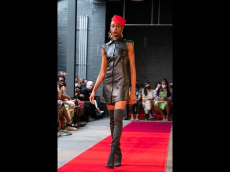 Theophilio kept the image of air hostesses in hats alive with this sexy black number which incorporates a pop of colour with this red stewardess' cap.