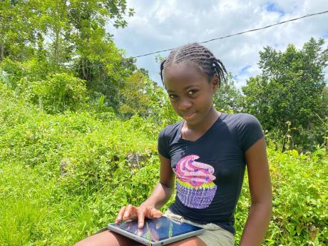 Eleven-year-old Coniesea McFarlane, who wants to take the COVID-19 vaccine so she can return to the physical classroom.