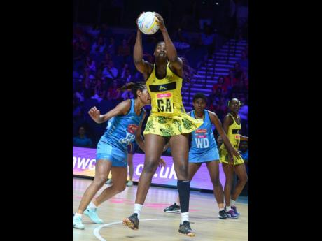 Jamaica goal attack Romelda Aiken takes control of the ball during their Vitality Netball World Cup match against Fiji at the M&S Bank Arena in Liverpool, England on Friday, July 12, 2019.