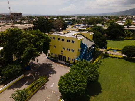 An aerial view of Merl Grove High School in St Andrew. The school's administration is in the throes of turmoil after the principal was suspended.