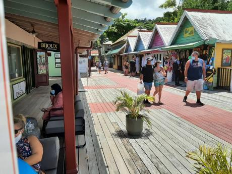 Tourists from the Carnival Sunrise cruise ship shopping at Island Village in Ocho Rios, St Ann, yesterday.