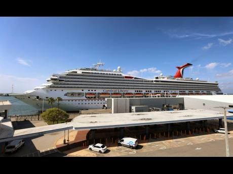 In this May 12 photo, a Carnival cruise ship, 'Liberty', is docked at Port Canaveral, Florida.