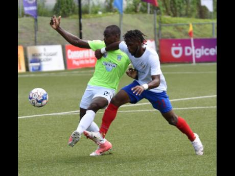 Elvis Wilson (left) of Waterhouse and Portmore United's Jevoun Bascoe in a keen tussle for the ball during their Jamaica Premier League match at the UWI-JFF-Captain Horace Burrell Centre of Excellence on September 10, 2021.