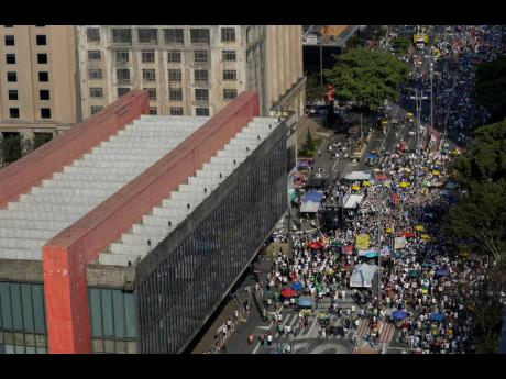 People gather next to the Art Museum during a protest against Brazilian President Jair Bolsonaro at Avenida Paulista, Sao Paulo, Brazil, on Sunday, September 12. WRI Brasil estimates that a greener response to COVID-19 could create two million additional j