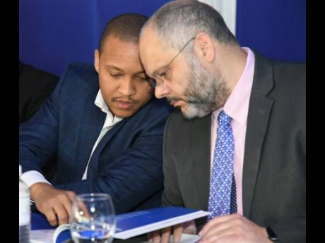 Deputy Chairman of Barita Investments Limited Paul Simpson (left) and Chairman Mark Myers.