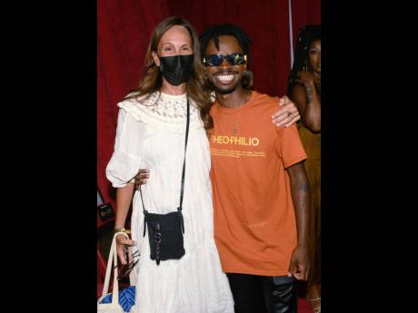 Veteran fashion designer Julie Gilhart supports the man of the hour, Edvin Thompson, the designer behind Theophilio.