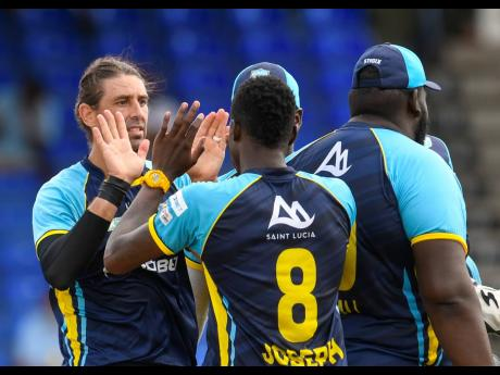 David Wiese (left) of Saint Lucia Kings celebrates the dismissal of Kieron Pollard of Trinbago Knight Riders during the 2021 Hero Caribbean Premier League Play-Off match between Saint Lucia Kings and Trinbago Knight Riders at Warner Park Sporting Complex y