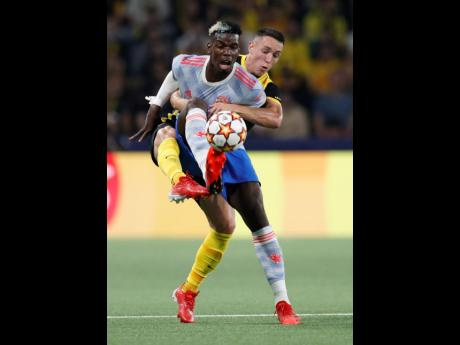 Manchester United's Paul Pogba (front) and YB's Silvan Hefti in action during of the Champions League group F match between BSC Young Boys and Manchester United, at the Wankdorf stadium in Bern, Switzerland, yesterday. Young Boys won 2-1.