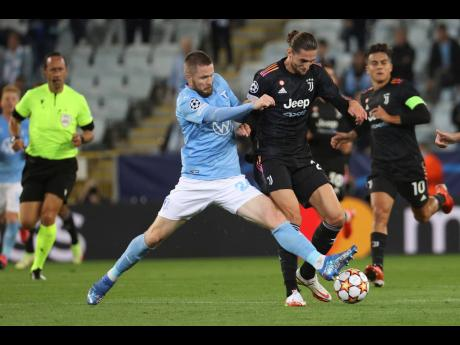 Malmo's Lasse Nielsen (left) and Juventus' Adrien Rabiot battle for the ball during the Champions League group H match between Malmo FF and Juventus FC at Malmo New Stadium in Malmo, Sweden, yesterday. Juventus won 3-0.