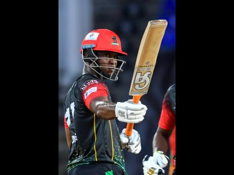 Evin Lewis of Saint Kitts and Nevis Patriots celebrates his half century during the 2021 Hero Caribbean Premier League Play-Off match between Guyana Amazon Warriors and Saint Kitts and Nevis Patriots at Warner Park Sporting Complex yesterday. The Patriots