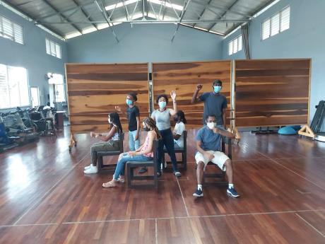 A few of Mignott's students behind the scenes participating in rehearsals.