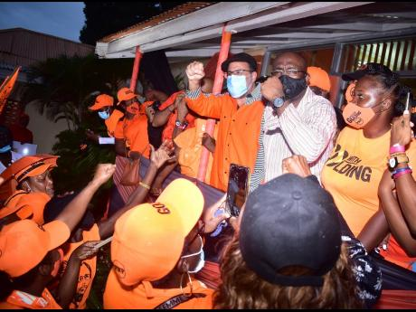 Mark Golding celebrates with fellow Comrades at PNP Headquarters on Old Hope Road in St Andrew in November 2020 after he was elected the president of the party.