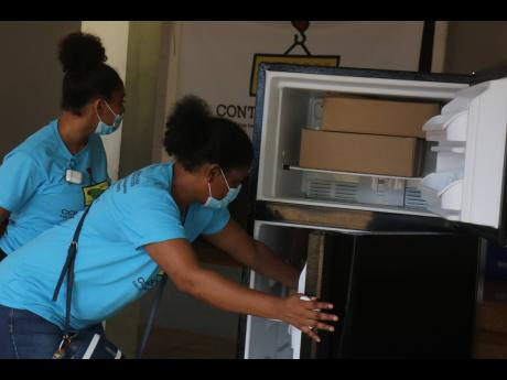 Members of the Hanover Charities team check out one of the stocked refrigerators.