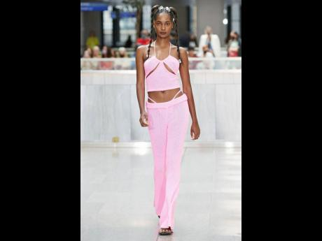 Tami Williams walks for Victor Glemaud's playful collection presented inside the 'new gateway to New York', the Moynihan Train Hall.