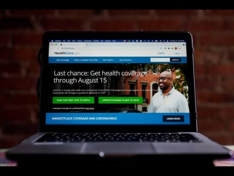 The HealthCare.gov website is photographed in Washington on Friday, August 13. AP