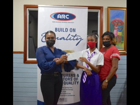 Dupont Primary's top PEP performer is on her way to achieving her dreams of becoming a dentist following ARC Manufacturing's contribution to offset tuition and book expenses for the new academic year. Lakaica Greenland (centre) was joined by her mother