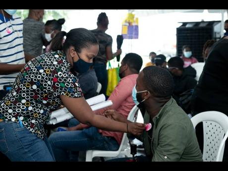 The LASCO Affiliated Companies and delegates of the Ministry of Health and Wellness came out in full force to host a vaccination blitz for 278 employees and dependents at the company's White Marl complex in St Catherine recently.  This initiative was exe