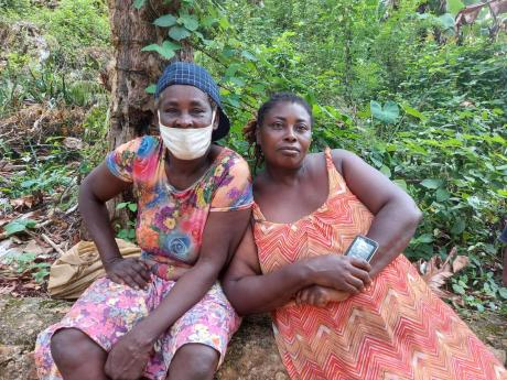 Sixty-six-year-old Nora Henry (left) and her daughter Marsha Edwards, both domestic workers of Top Bellefield in Manchester, say it has been a rough road finding employment and providing for their families during the pandemic.