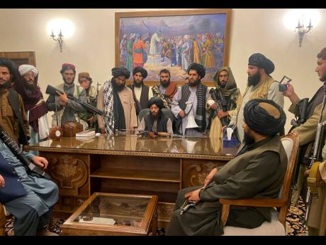 Taliban fighters take control of Afghan presidential palace in Kabul, Afghanistan, after President Ashraf Ghani fled the country on August 15.