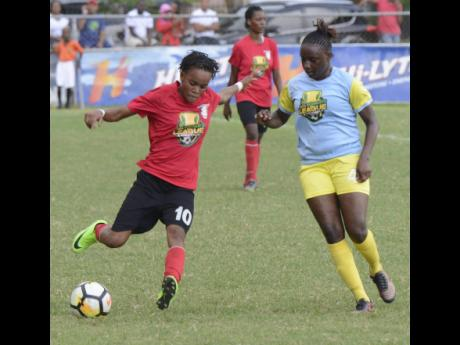 Arnett Gardens' Shanel Spence (left) tries to get by Waterhouse's Nevillegail Able during their JFF Women's Football League mid-season final at Winchester Park in Kingston on Sunday, August 19, 2018.
