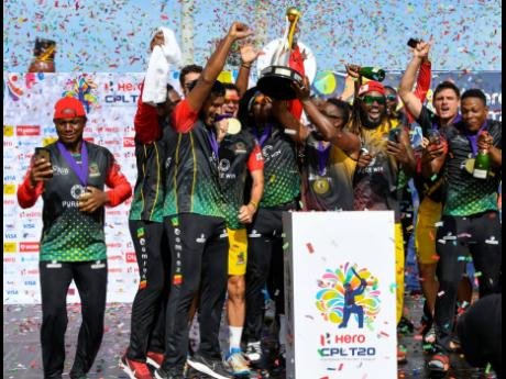 St Kitts and Nevis Patriots players celebrate with the trophy after winning the 2021 Hero Caribbean Premier League final against St Lucia Kings at Warner Park Sporting Complex in Basseterre, St Kitts and Nevis, yesterday.