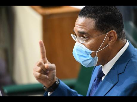 Prime Minister Andrew Holness gestures during his presentation at the sitting of the House of Representatives in Kingston on Wednesday.