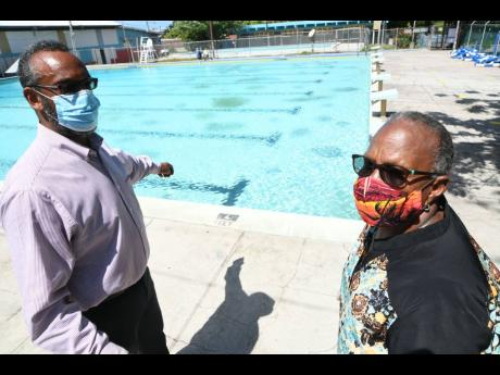 Sarah Newland Martin, administrator and general secretary of the YMCA, is seen here with Allan Marsh, chairman, beside a swimming pool on the Y's Hope Road compound in this July 20, 2020, photograph.