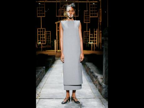 Tami Williams wears one of the sleeveless shift-like pieces presented in the collection.