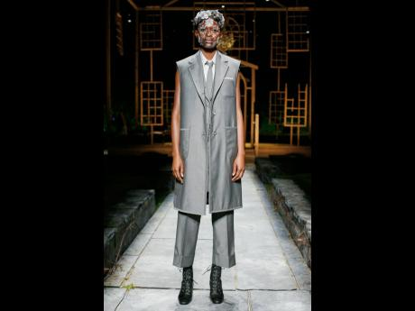 Barbra-Lee Grant walks in the Thom Browne Spring/Summer 2022 fashion show.
