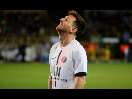 PSG's Lionel Messi reacts in disappointment during their 1-1 draw with Club Brugge in their UEFA Champions League Group A match at the Jan Breydel Stadium in Bruges, Belgium, on Wednesday.
