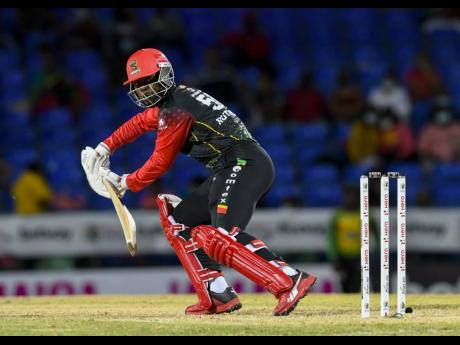 St. Kitts and Nevis Patriots' Sherfane Rutherford scores during his unbeaten half century against the Tamaica Tallawahs, in their Hero Caribbean Premier League T20 cricket match at Warner Park in St. Kitts on September 1, 2021.