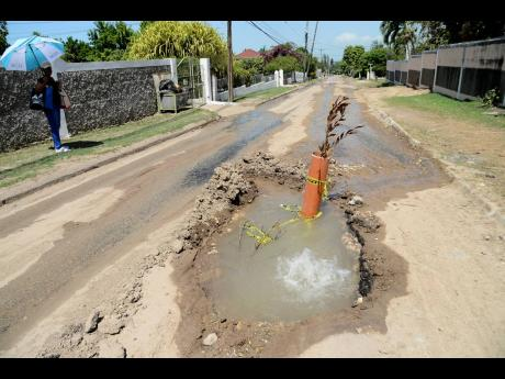 In this June 2019 photo, a section of Charlemont Drive in Hope Pastures, St Andrew, that was dug up by the National Water Commission to repair a water main. In August, newly reinstated roadway collapsed, exposing recently laid sewerage lines. After variou