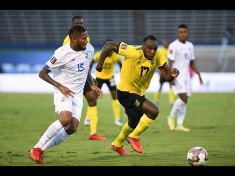Jamaica's Michail Antonio (right) blasts past Panama's Eric Davis Grajes during their CONCACAF World Cup qualification football match at the National Stadium on Sunday, September 5, 2021. Antonio scored in West Ham's 2-0 Europa League victory over Di