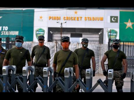 AP Pakistan paramilitary troops stand guard outside the Pindi Cricket Stadium following the cancellation of the first one-day international cricket match between Pakistan and New Zealand, in Rawalpindi, Pakistan, yesterday. New Zealand abandoned its cricke