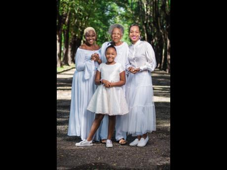 Dr Terri-Karelle Reid considers herself extremely lucky to be part of a four-generation family that is female and that has simultaneously inspired and kept her grounded. From left: Mother, Donna; grandmother, Jeanie; and Terri-Karelle. Front: Daughter, Na