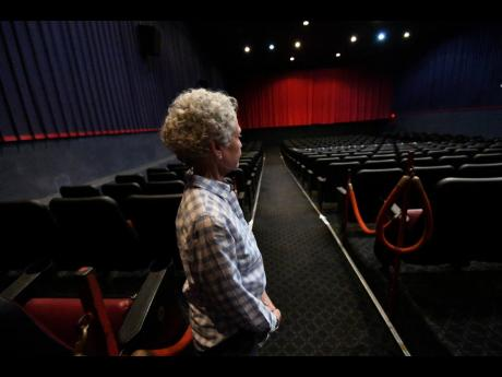 Melanie Graham, marketing manager and director of Palace Amusement stands inside one of the five theatres at Carib 5 in Cross Roads, Kingston.