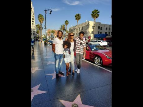From left: Dane McAlpin, Kyrie McAlpin, Kadene McAlpin and DeLijah McAlpin take a trek down the Hollywood Walk of Fame.