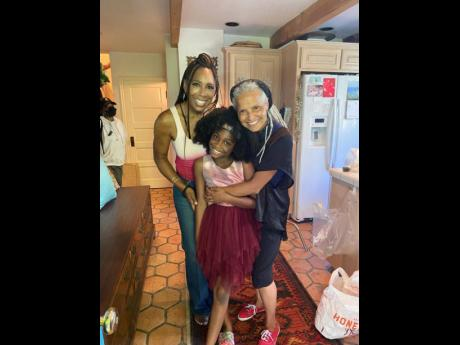 Award-winning actresses Dawnn Lewis (left) and Victoria Rowell sandwich Kyrie McAlpin while on set of the 'Blackjack Christmas' movie, which is set to be released later this year.