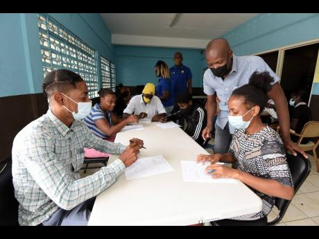 Ian Allen/Photographer  Courtney Edwards (second right), councillor for the Independence City division in Portmore, St Catherine, interacting with unattached youth during a training session at the Independence City Community Centre on Thursday, September 1